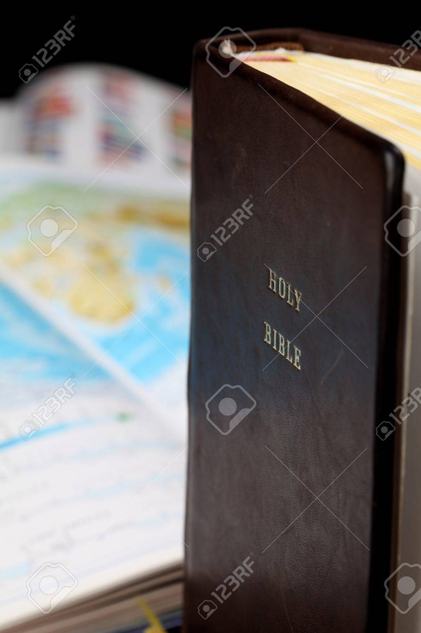 Holy Bible and a world map in the background. World missions concept. Copy space. Stock Photo - 8878183