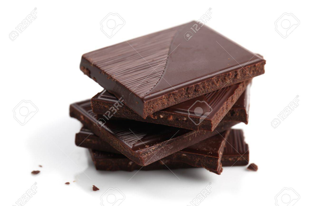 Stack of dark chocolate pieces on white background. Shallow dof Stock Photo - 9079435