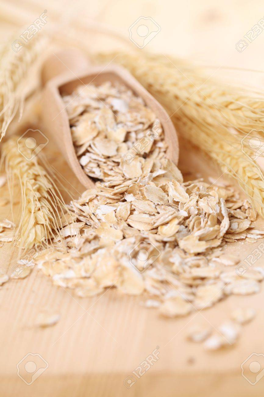 Wooden scoop with oats Stock Photo - 9888807