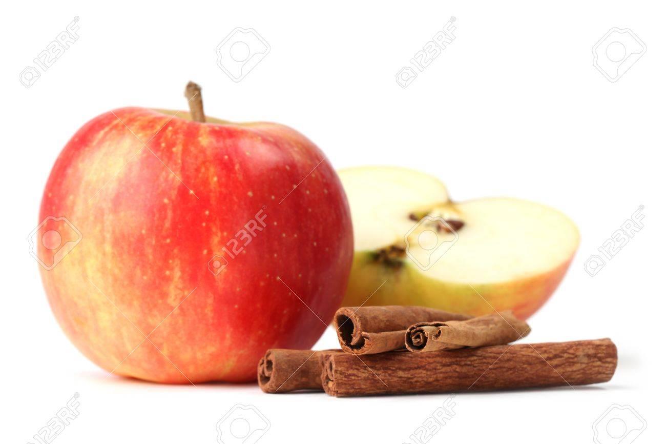 Apples and cinnamon sticks on white background. Shallow dof Stock Photo - 10029402