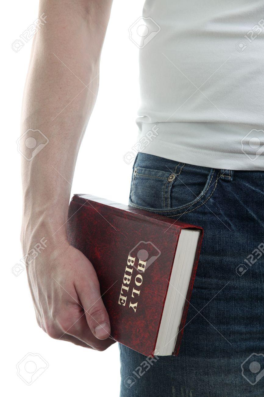 Man holding the Holy Bible, isolated on white background Stock Photo - 12199969