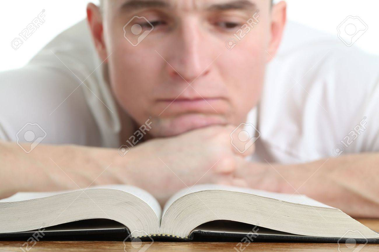 Man studying the Bible. Focus on the Bible Stock Photo - 12200000