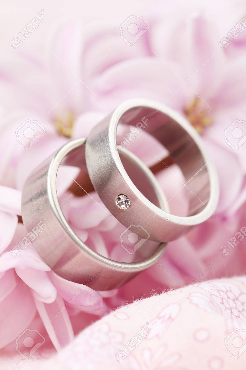 Titanium Wedding Rings On Pink Background With Hyacinth Shallow ...