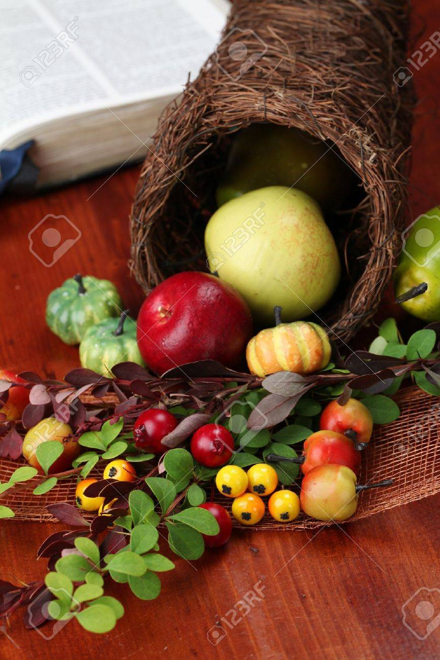 Thanksgiving arrangement with cornucopia and the Bible in background Stock Photo - 15083493