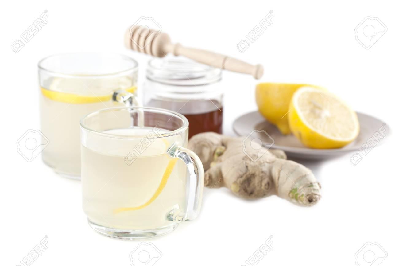 Ginger tea with honey and lemon isolated on white background Stock Photo - 15970028