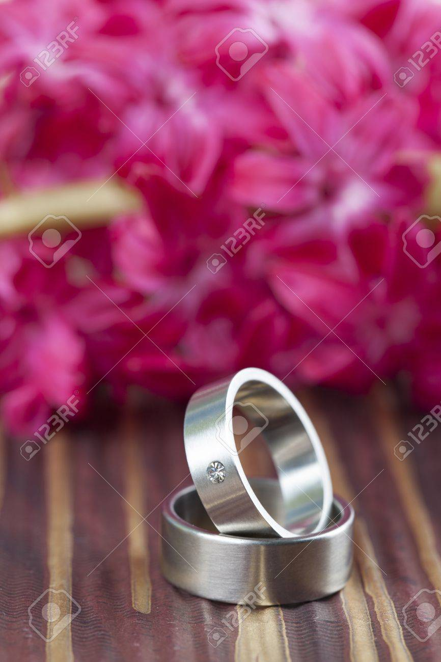 Titanium Wedding Rings With Red Hyacinth In The Background Shallow ...