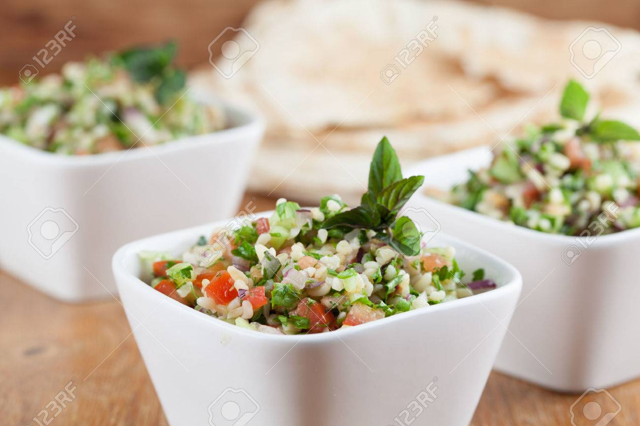 Gourmet Middle Eastern salad Tabbouleh in white bowls Stock Photo - 23015098