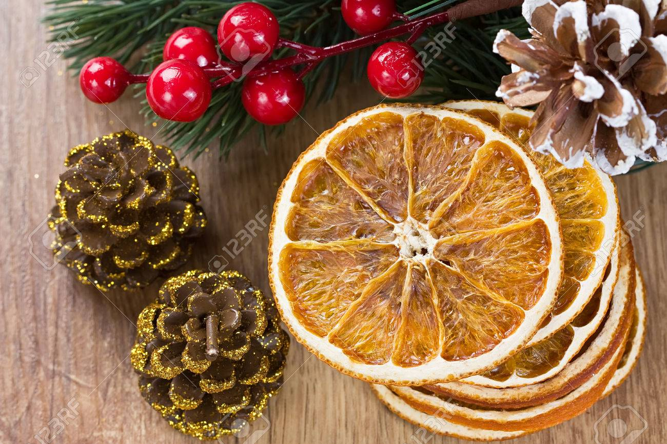 Dried Orange Slices And Christmas Decorations On Wooden Background