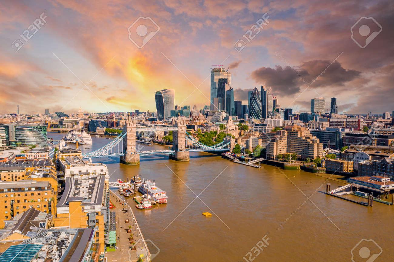 Tower Bridge in London, the UK. Bright day over London. Drawbridge opening. - 167850154
