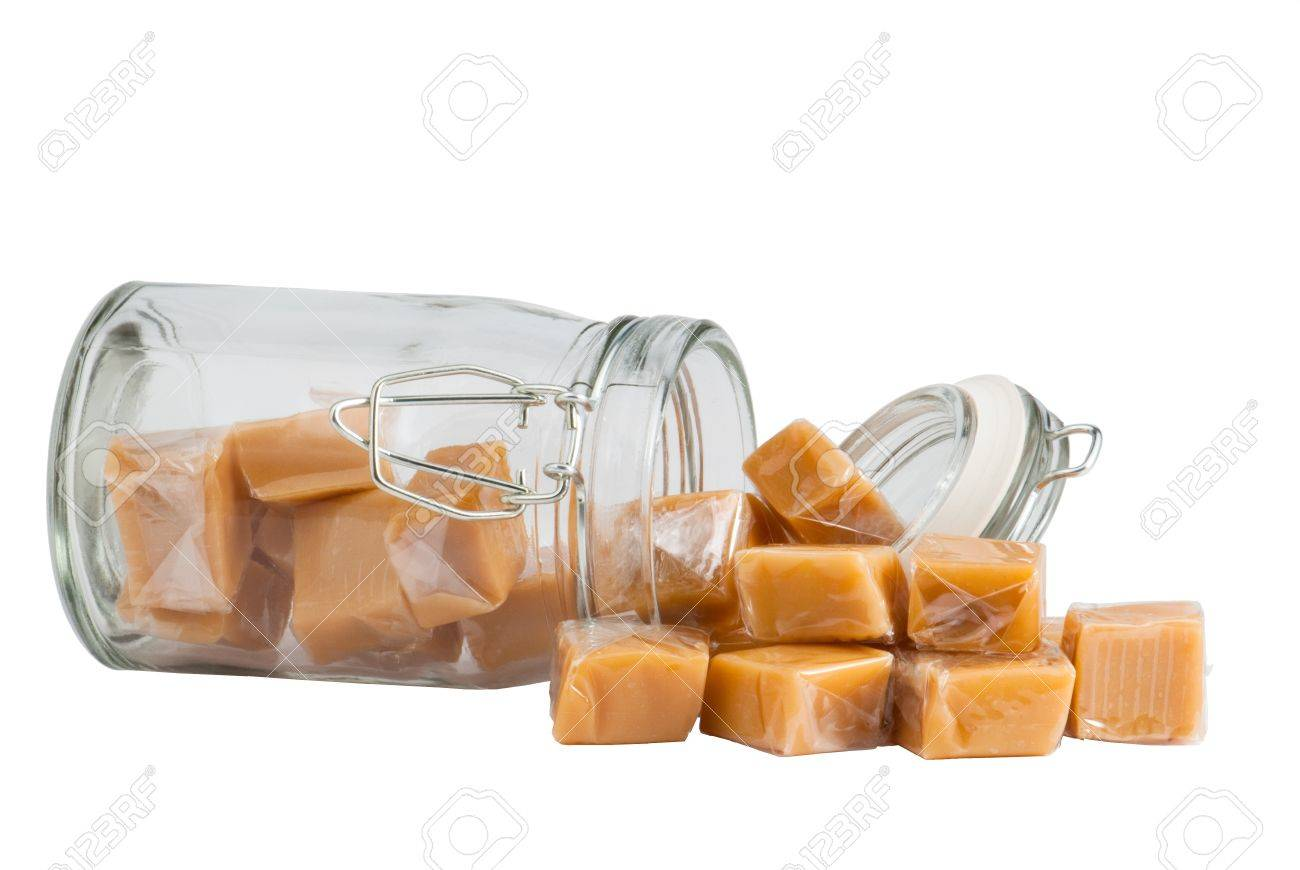 Light brown caramel sweets in a glass, isolated Standard-Bild - 9886273