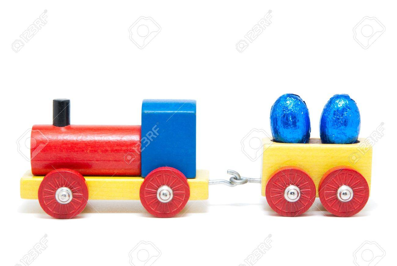 Colorful wooden model railway with Easter eggs on goods waggons, isolated Standard-Bild - 9886318