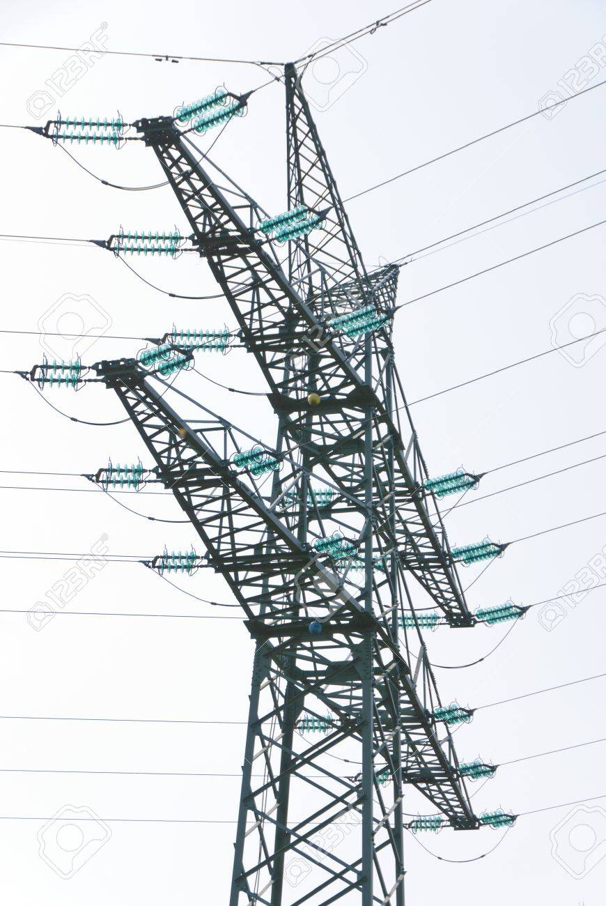 Tension tower with traverses of a high-voltage line Standard-Bild - 13284982