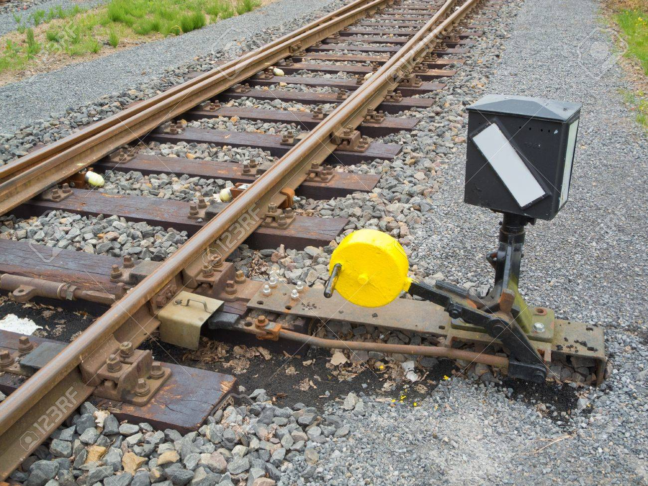 Hand-operated railroad switch with lever, weight and signal Stock Photo - 13883402