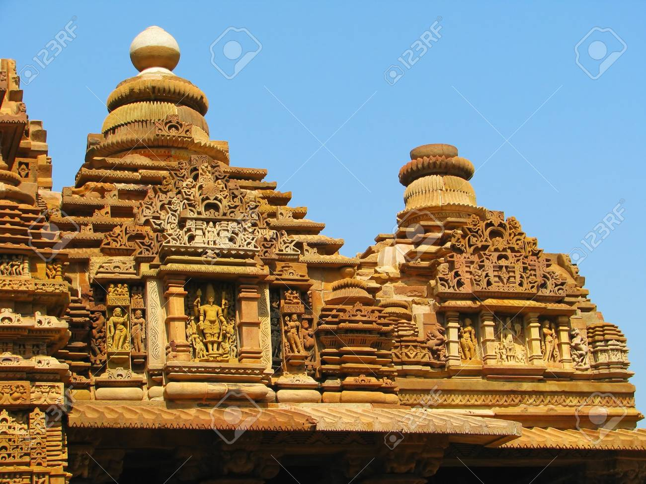 Stone carved temple with erotic sculptures in Khajuraho, Madhya Pradesh, India Stock Photo - 13060844