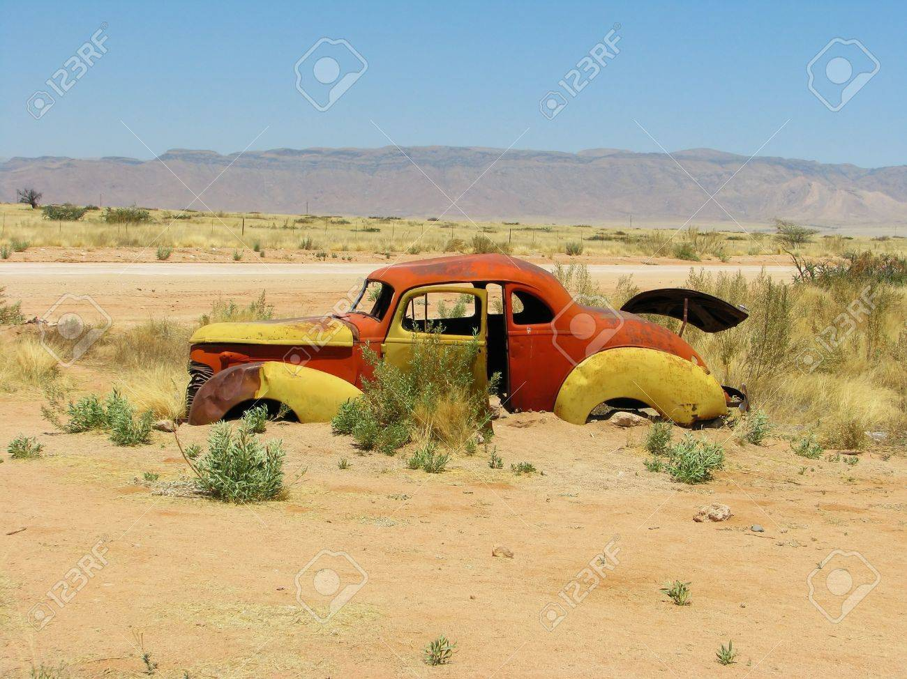 Old car wreck on Namibian desert, Solitaire, Namibia Stock Photo - 13591179