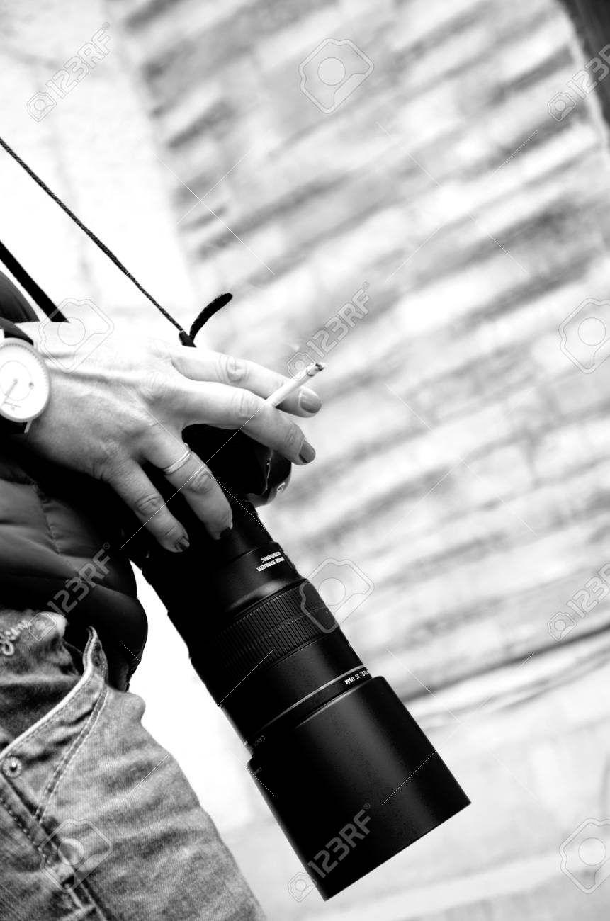 Stock photo young woman holding a dslr camera black white photography
