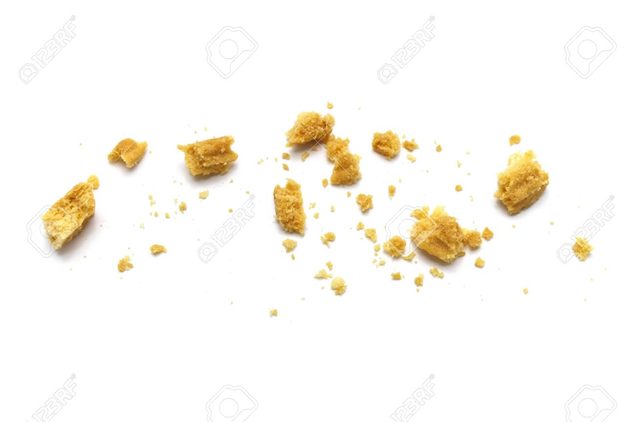 Scattered crumbs of butter cookies on white background. - 150102010