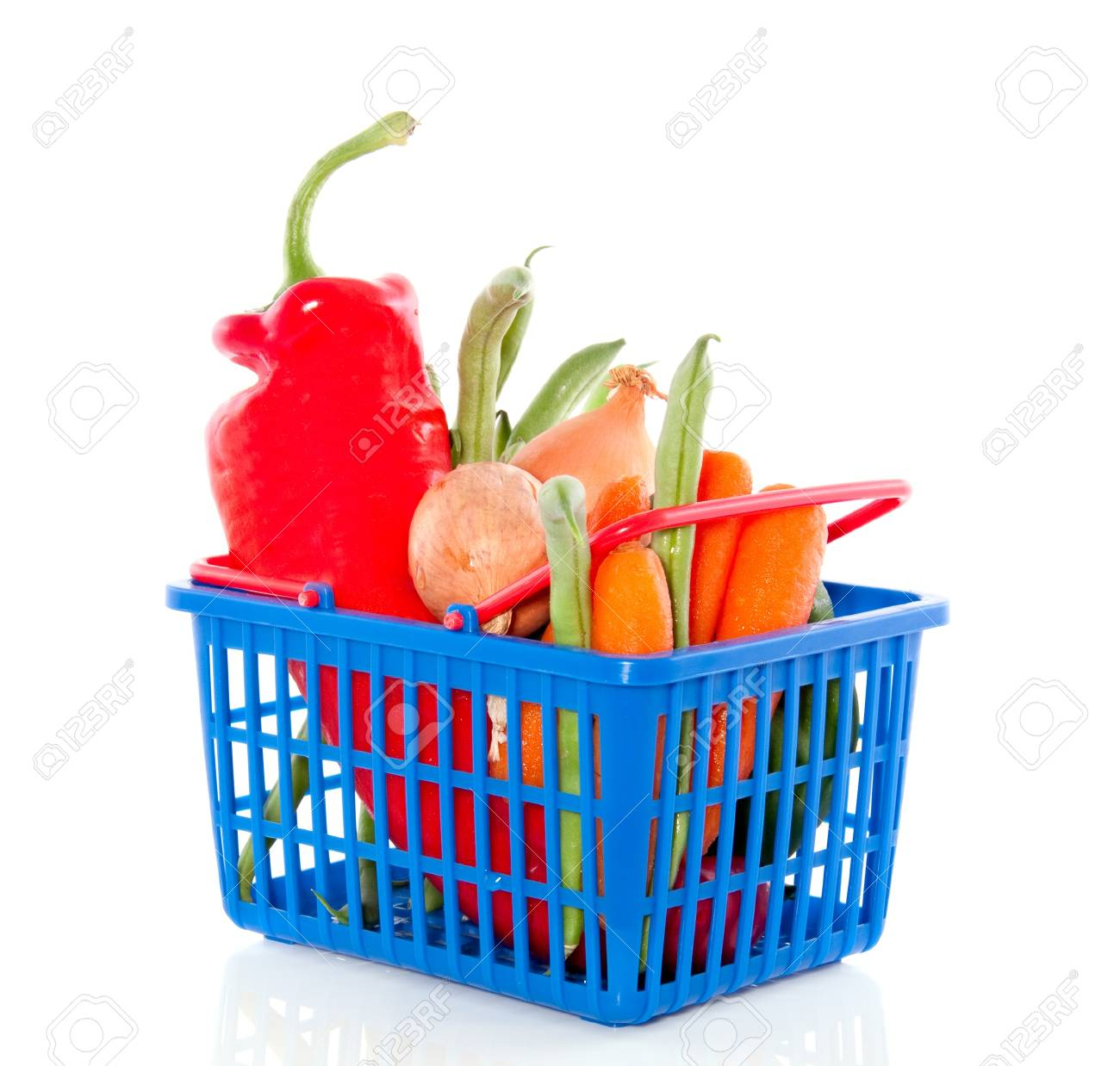 fresh vegetables in a plastic shopping basket isolated over white Stock Photo - 12197425