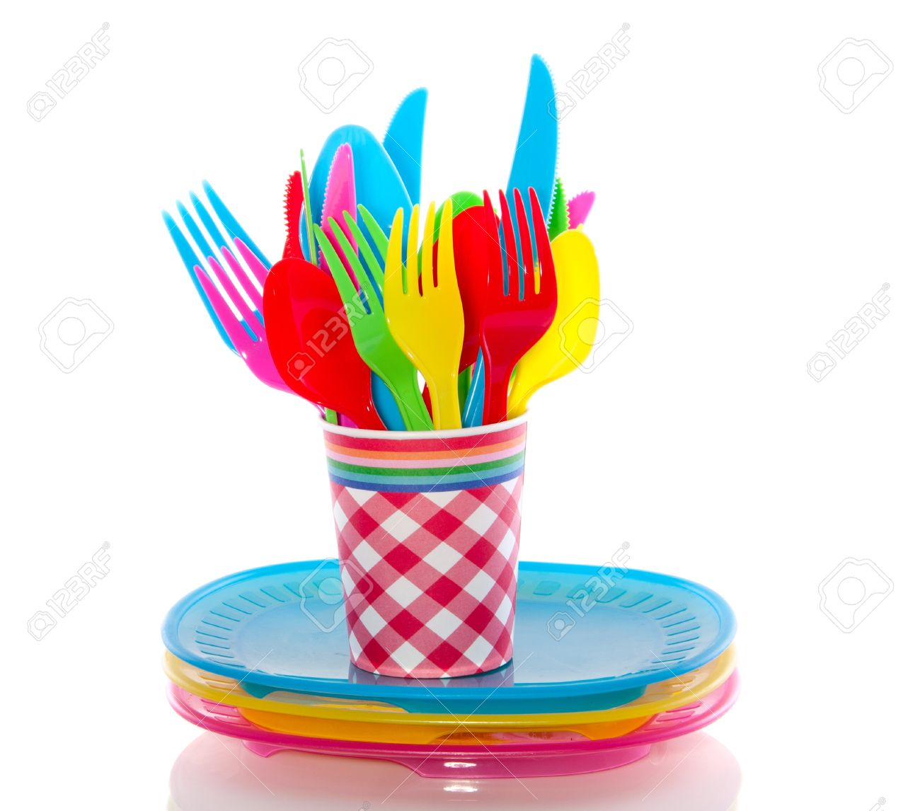 colorful plastic cutlery in a cup on plates isolated over white Stock Photo - 18706617  sc 1 st  123RF.com & Colorful Plastic Cutlery In A Cup On Plates Isolated Over White ...