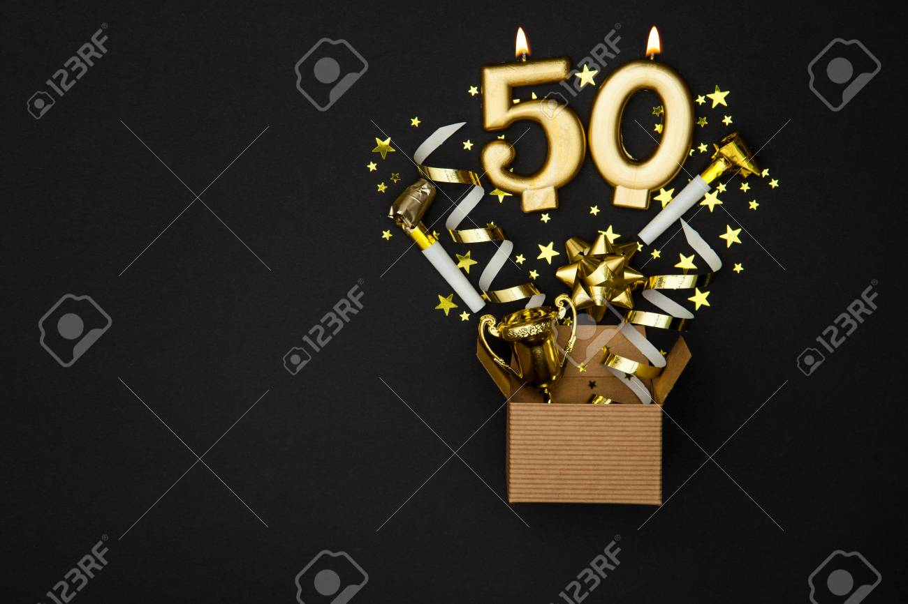 Number 50 gold celebration candle and gift box background - 91935377