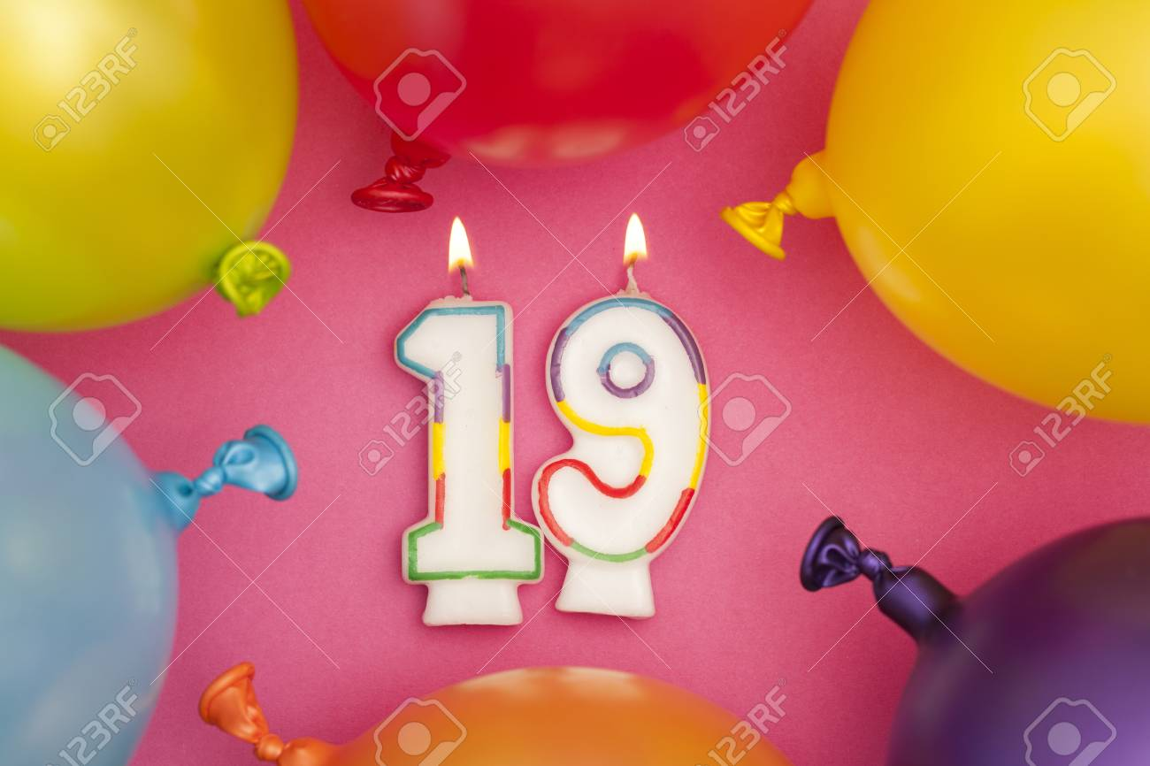 Happy Birthday Number 19 Celebration Candle With Colorful Balloons Stock Photo