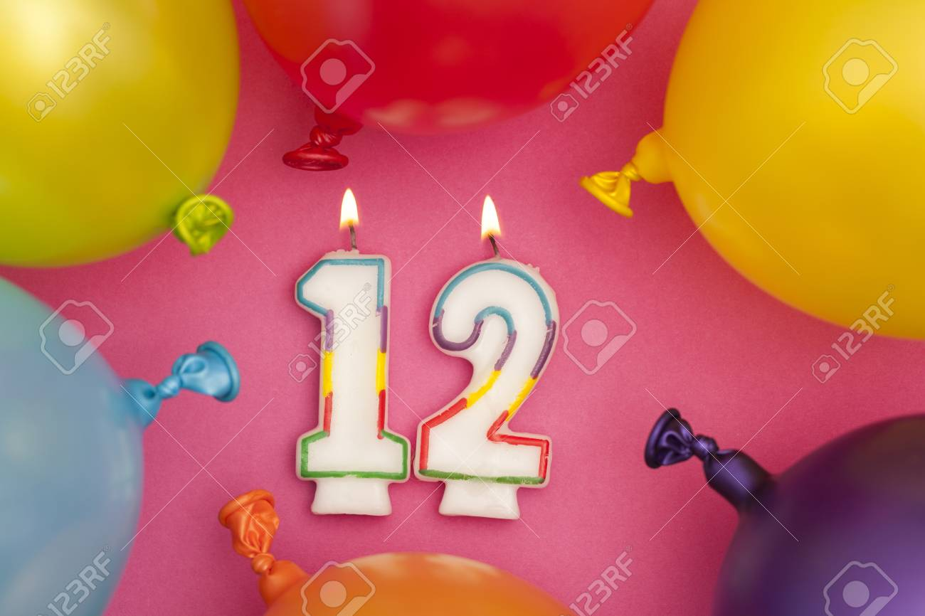 Happy Birthday Number 12 Celebration Candle With Colorful Balloons Stock Photo