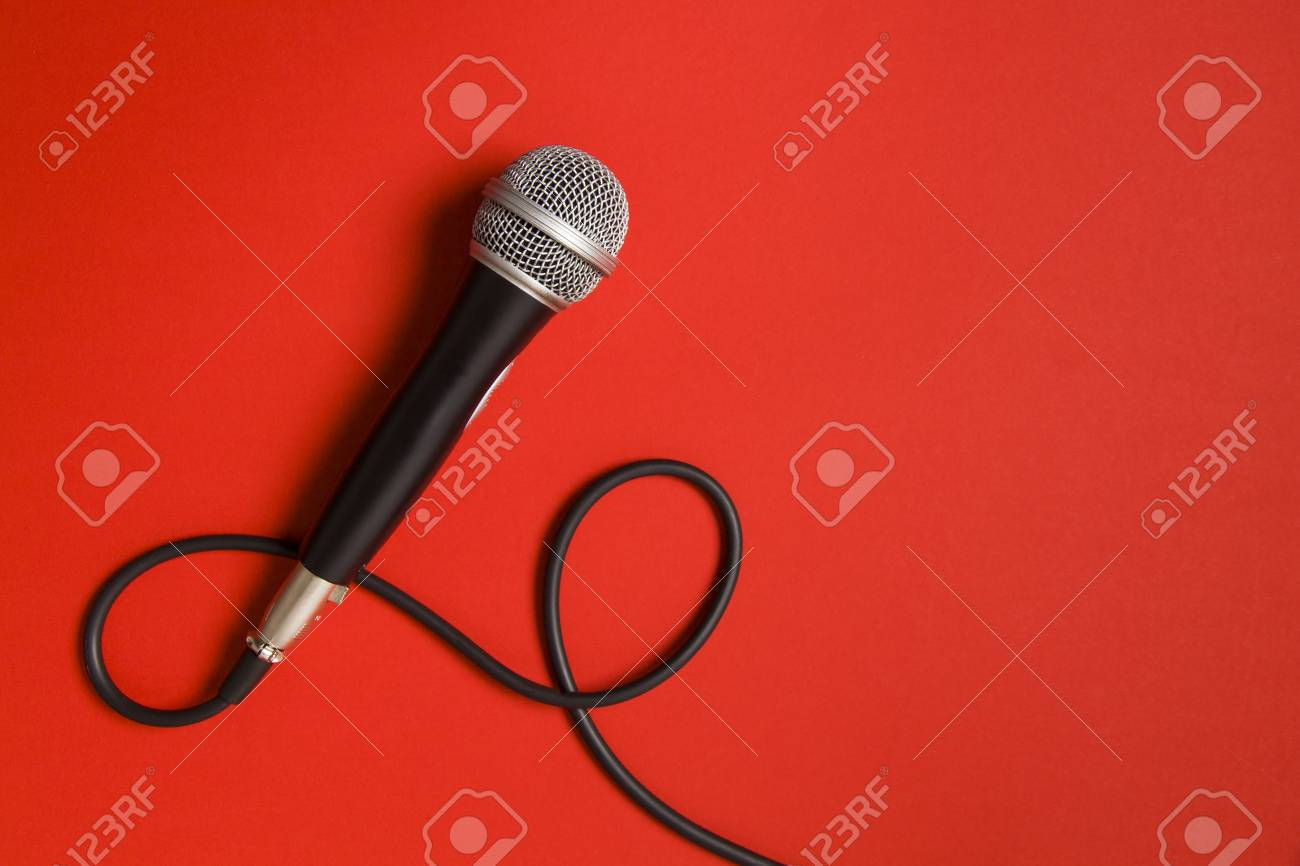 microphone and lead on a bright red background. - 92728844