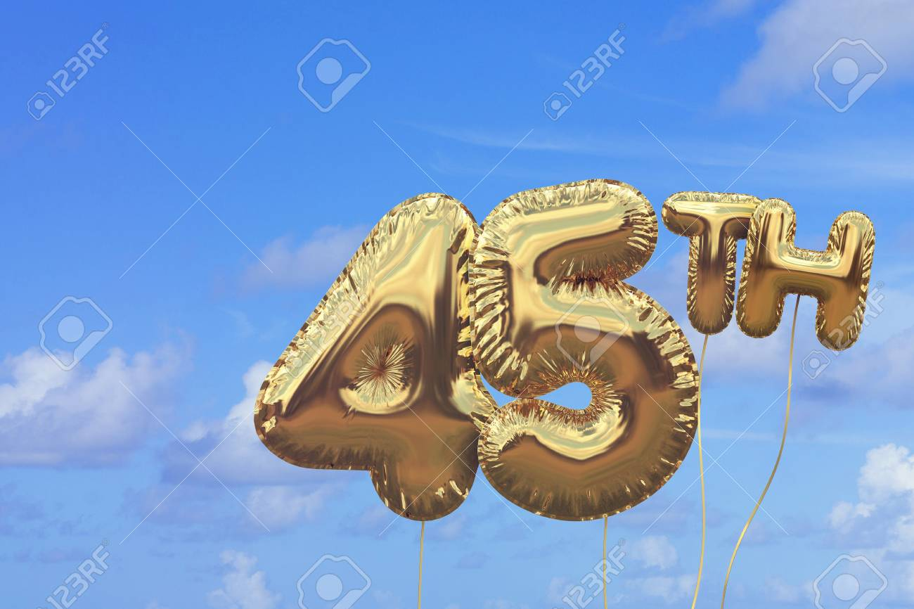 Gold Number 45 Foil Birthday Balloon Against A Bright Blue Summer Sky Golden Party Celebration