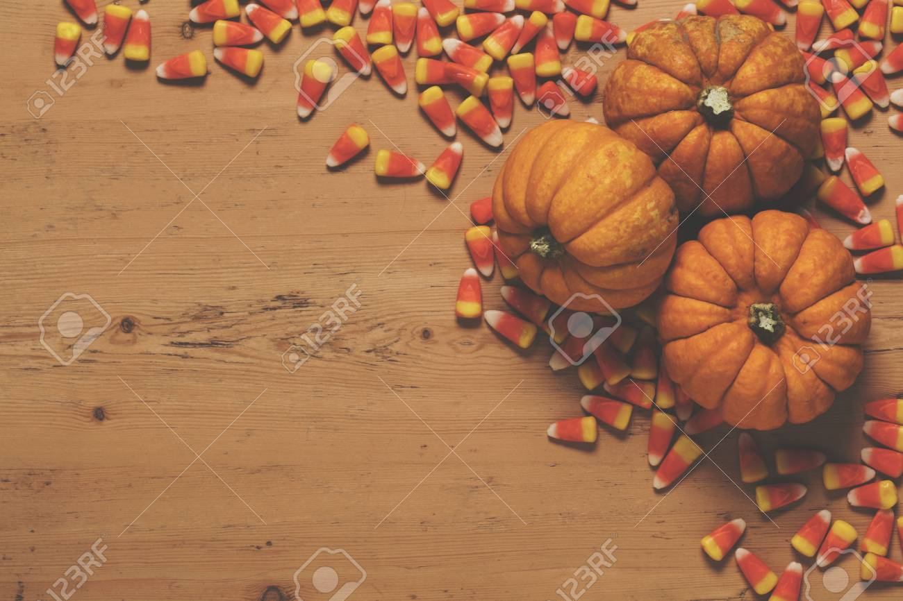 Pumpkin And Candy Corn Autumn Halloween Background