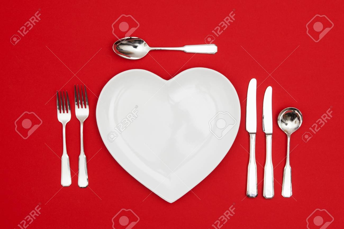 Heart shaped plate with knife and fork on a red background Stock Photo - 93988609 & Heart Shaped Plate With Knife And Fork On A Red Background Stock ...