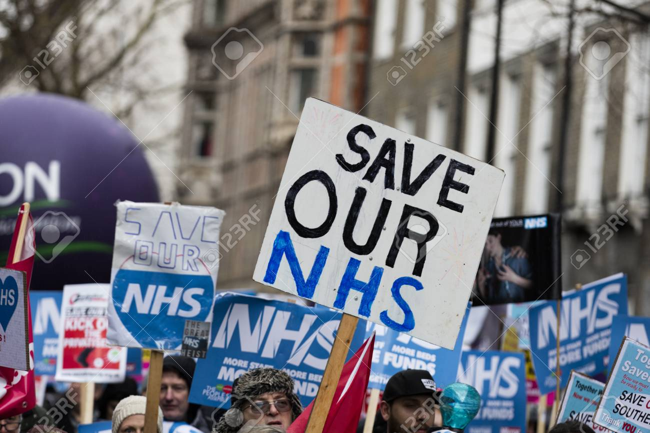 LONDON, UK - February 3rd 2018: Protesters and campaigners on a save the NHS march in central London - 96497376