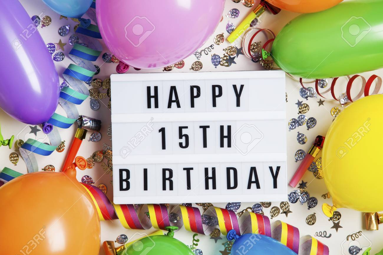 Happy 15th Birthday Celebration Message On A Lightbox With Balloons And Confetti Stock Photo