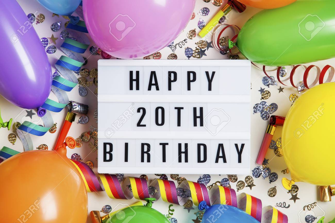 Happy 20th Birthday Celebration Message On A Lightbox With Balloons And Confetti Stock Photo