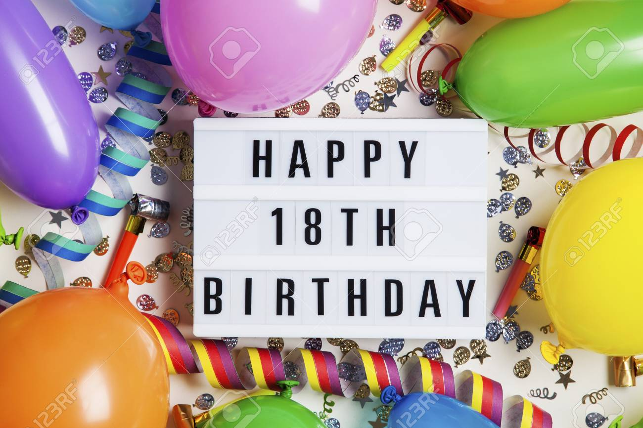 Happy 18th Birthday Celebration Message On A Lightbox With Balloons And Confetti Stock Photo