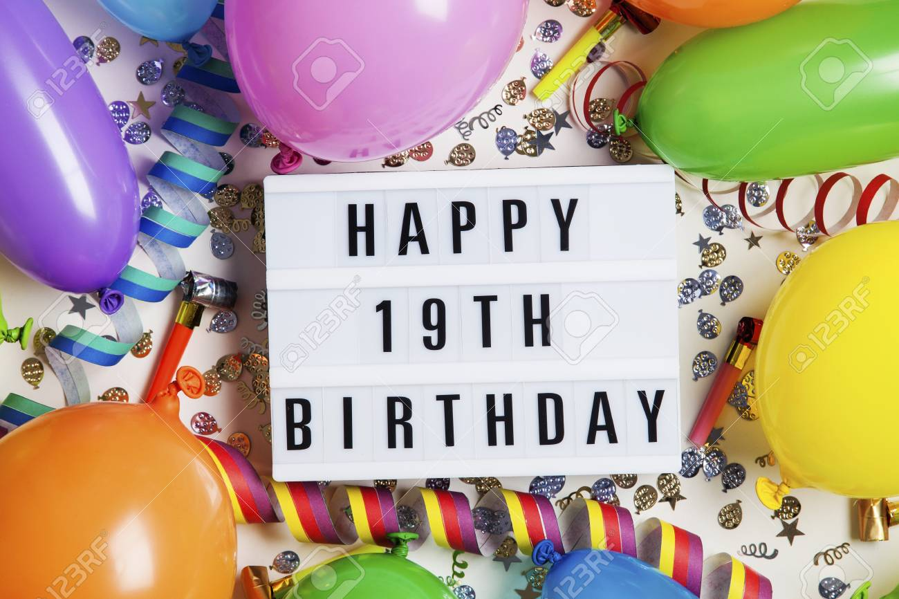Happy 19th Birthday Celebration Message On A Lightbox With Balloons And Confetti Stock Photo