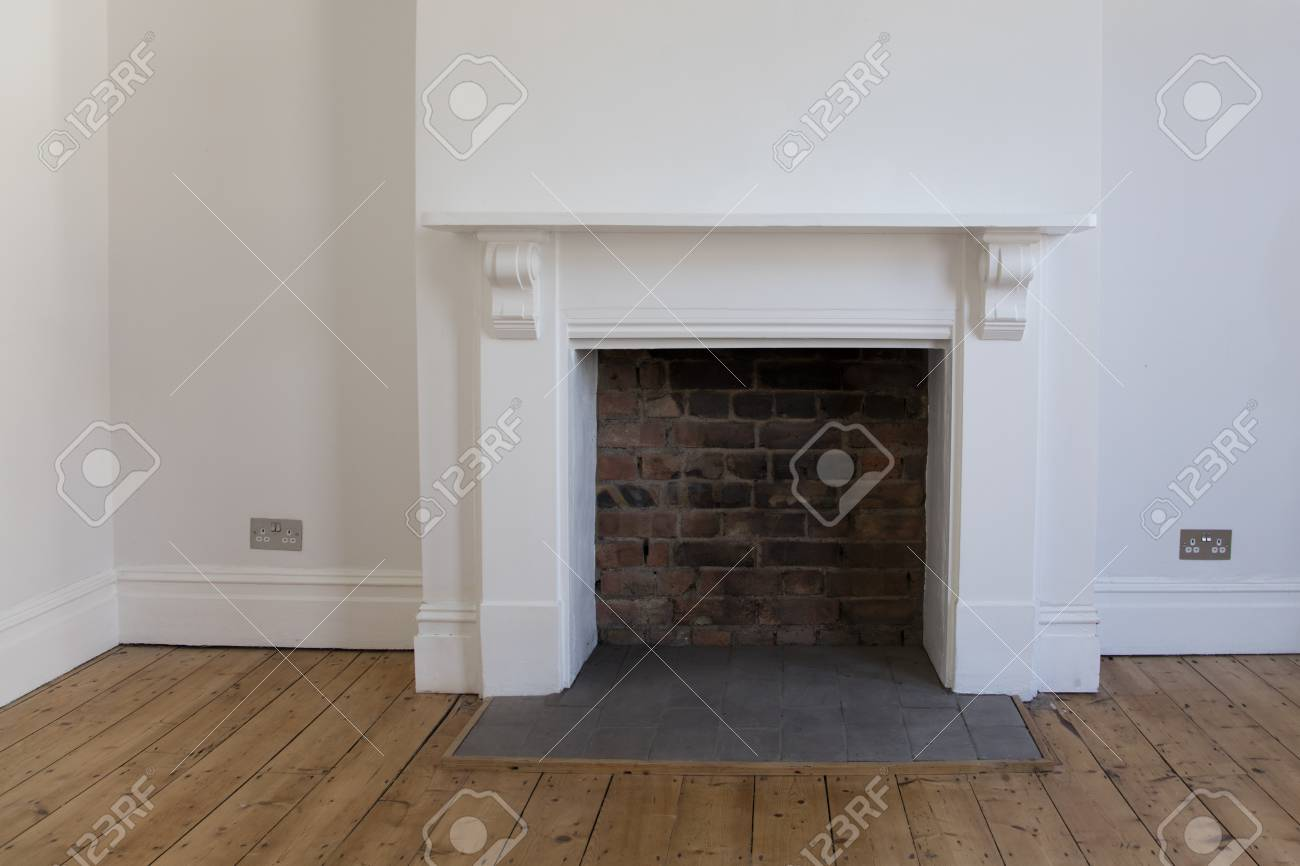 Victoriran Wooden Fireplace Surround With White Walls Stock Photo Picture And Royalty Free Image Image 99242412