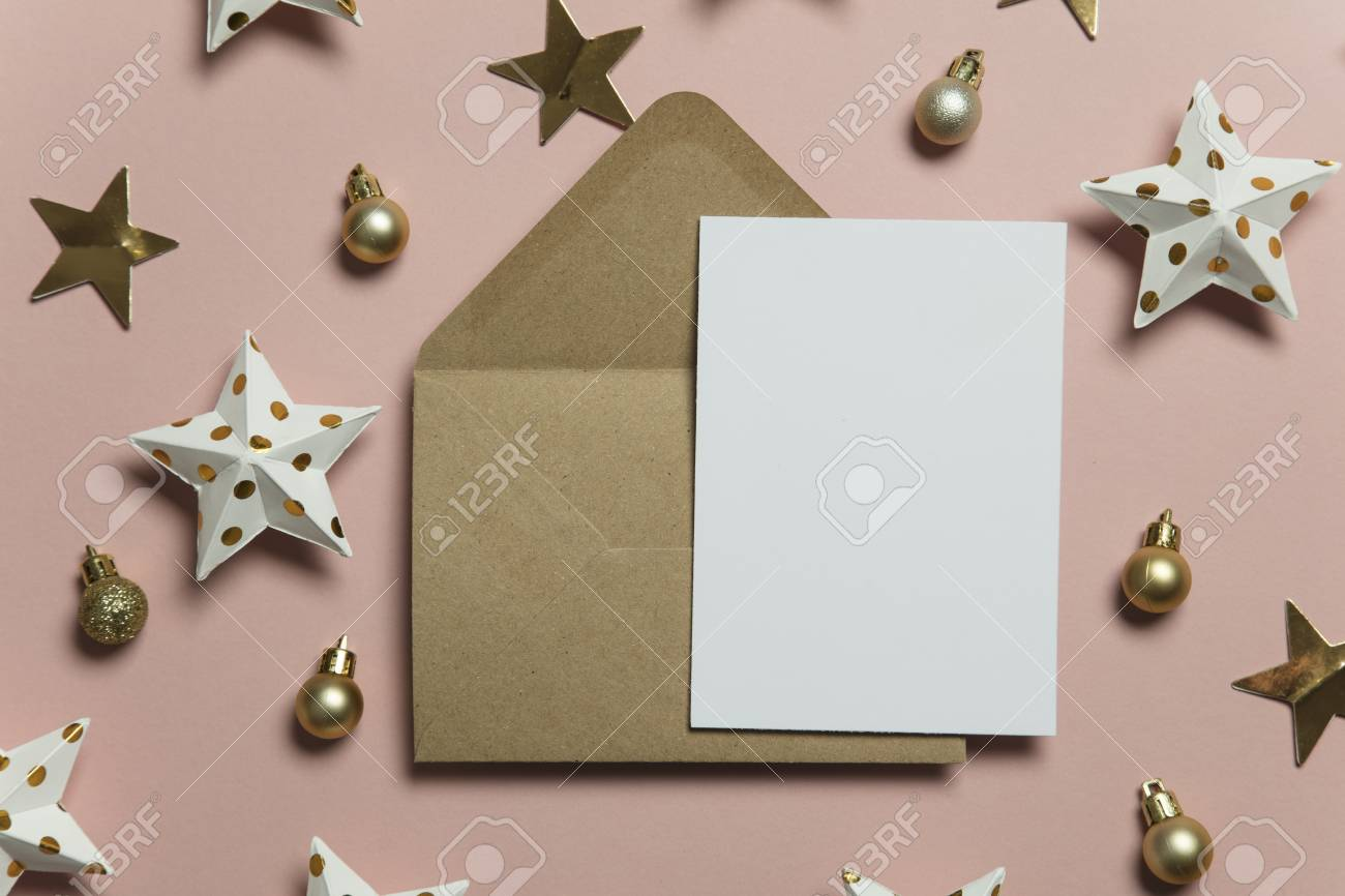 Christmas card template mock up. Blank card with envelope on pink background - 110990255