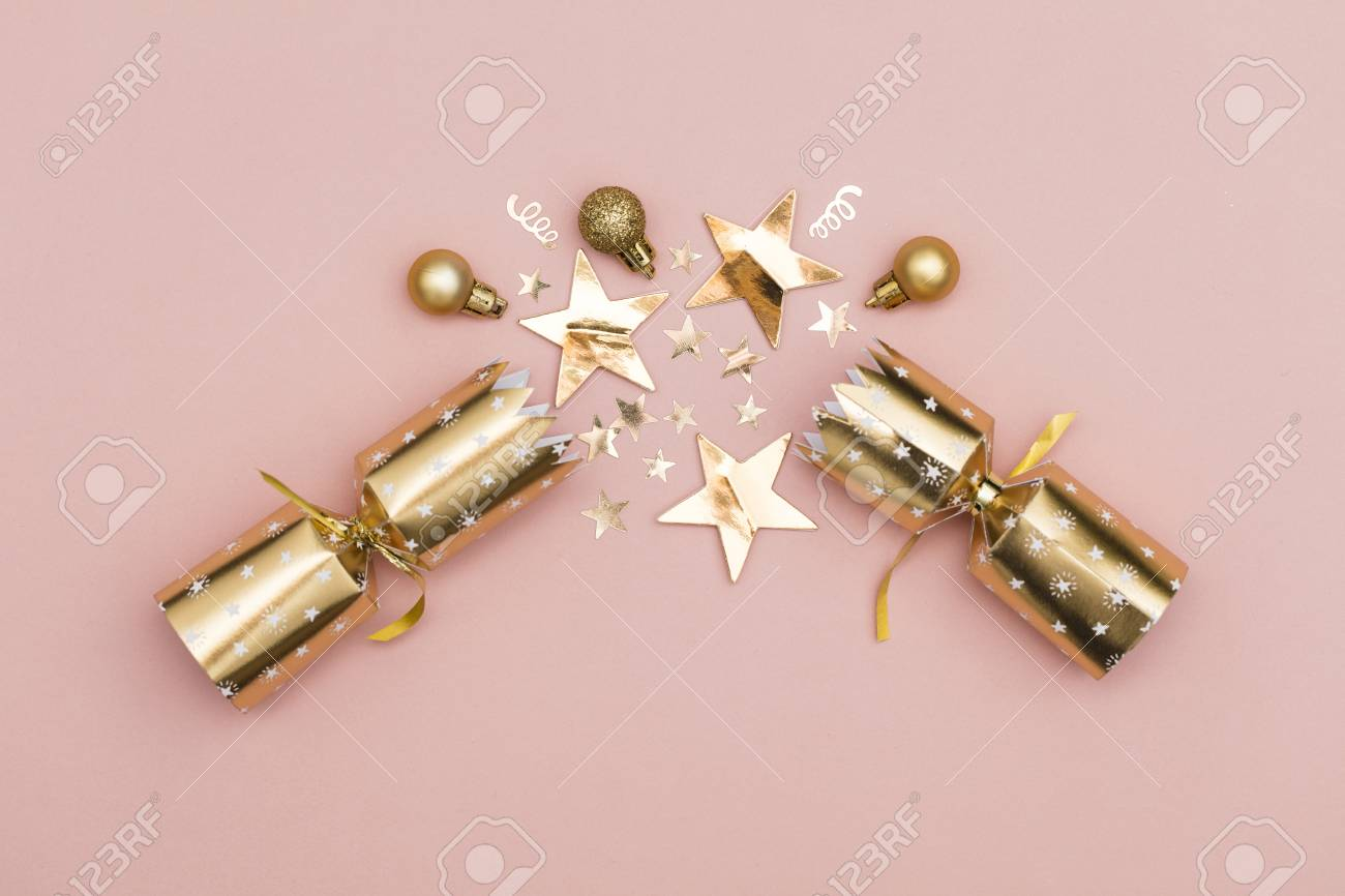 Christmas Crackers.Christmas Crackers Luxury Gold Festive Cracker On A Pastel Pink