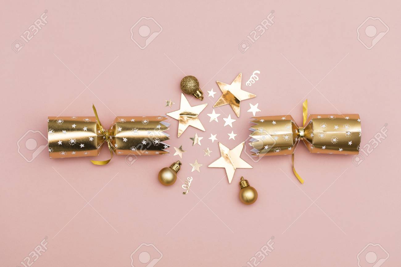 Christmas Crackers Luxury Gold Festive Cracker On A Pastel Pink Stock Photo Picture And Royalty Free Image Image 113341209