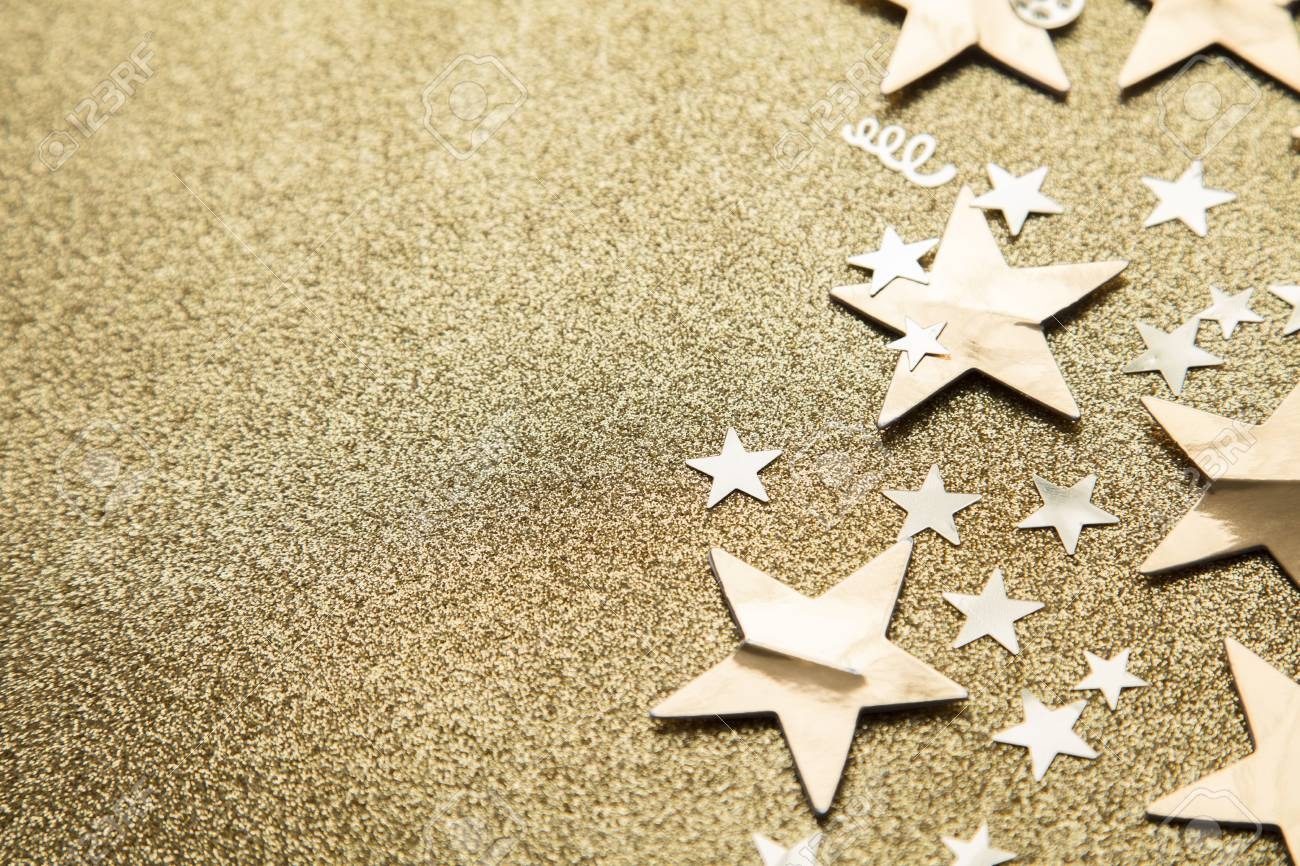 Gold star sparkle party confetti on a gold glitter background - 113805303