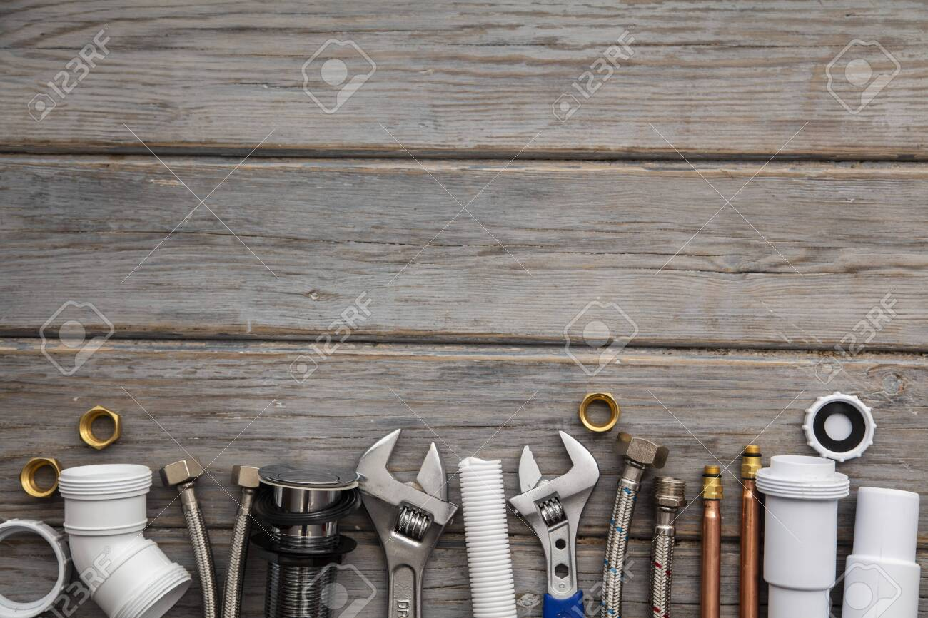 Plumping equipment on a wooden background. professional service background - 131461720