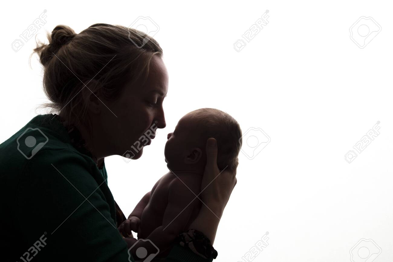 Silhouette of a mother holding her newborn baby - 132266009