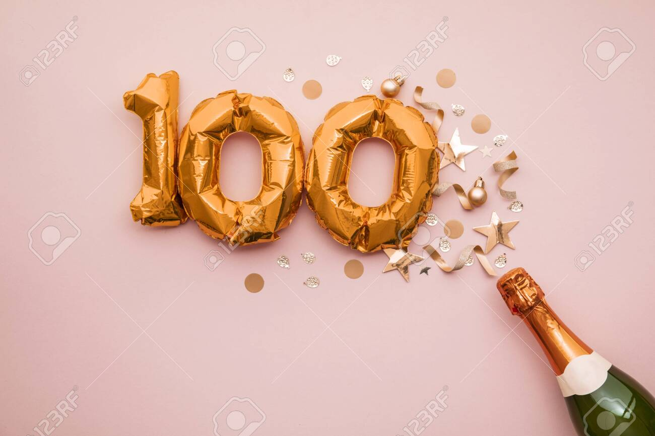 Happy 100th anniversary party. Champagne bottle with gold number balloon. - 136342337