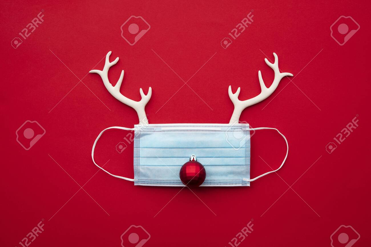 Festive christmas reindeer made from face mask and decorations - 157037431