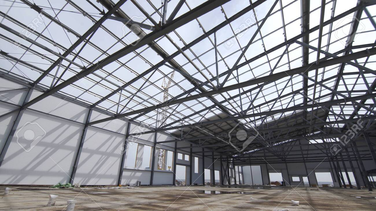 Construction of modern factory or warehouse, modern industrial exterior, panoramic view. Modern storehouse construction site, structural steel structure of new commercial building - 152899281