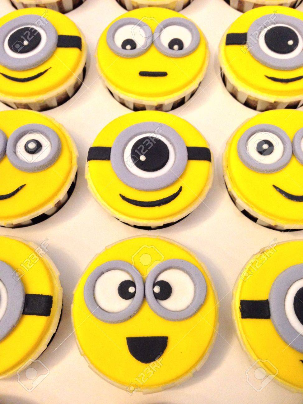 Fondant minions cupcakes stock photo picture and royalty free fondant minions cupcakes stock photo 24341233 baditri Image collections