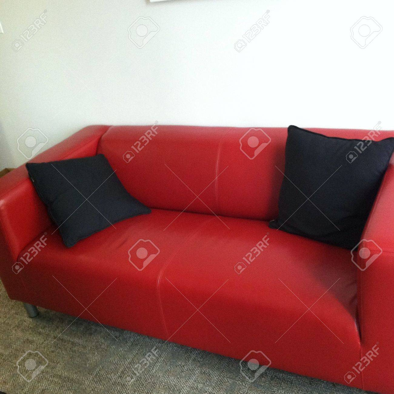 Red Couch With Black Pillows Stock Photo, Picture And Royalty Free ...