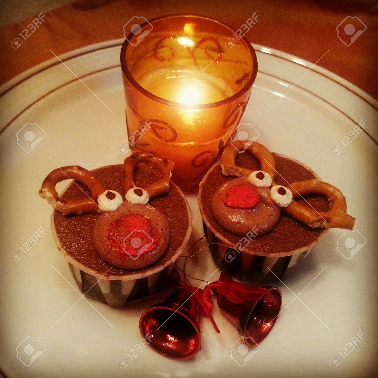 Chocolate Rain Deer Cupcakes With Dimly Lighted Fragrant Candle ...