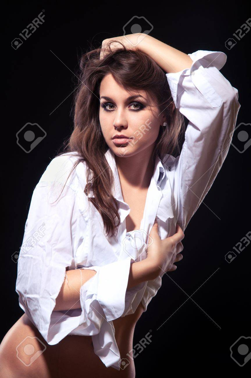 Young sexy woman in a white shirt Stock Photo - 12802943