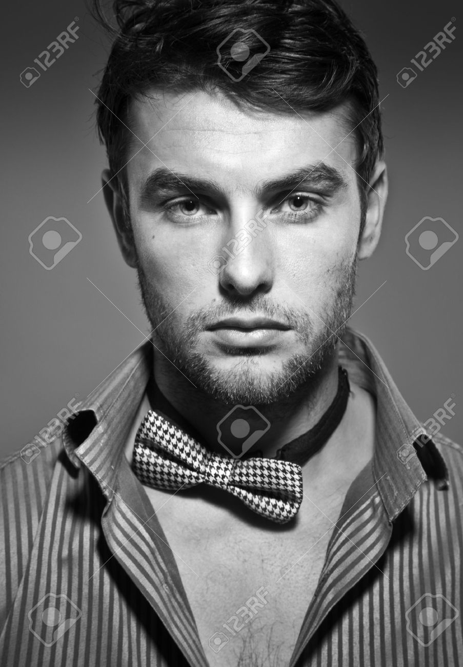 Stock photo young serious man close up black and white photo